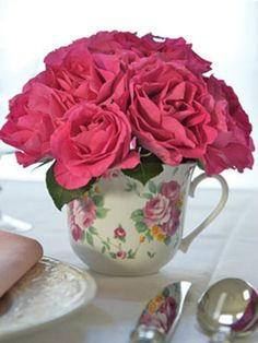 Life imitates art, and sweetly so. Start with a rose-patterned china cup and a bouquet of roses to match. Soak a foam brick in water for 30 minutes, cut it to fit neatly into a teacup, clip rose stems slightly shorter than teacup height and insert stems in foam, starting around the perimeter and moving toward the center. Create this just rosy to make a lovely centerpiece.