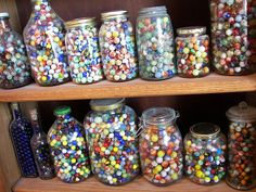 Marbles displayed in various bottles and jars (part of a much larger marble collection) ... wow!