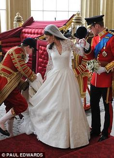 Buckingham Palace: Helped by her new husband, Catherine steps out of the carriage as it arrives at the Palace.
