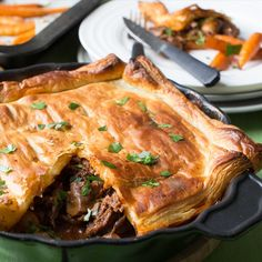 A tasty puff pastry beef and mushroom pie paired with boiled carrots, and topped with parsley to serve. Steak And Mushroom Pie, Steak And Mushrooms, Stuffed Mushrooms, Stuffed Peppers, Puff And Pie, Oven Dishes, Pastry Dishes, Beef Pot Pies, Slow Cooker Enchiladas