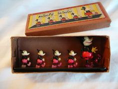 Mickey Mouse celluloid figures in original box, 1930's.