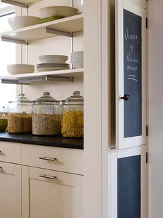 Store often-used kitchen staples in sealed glass jars, and set atop your counter. The jars look pretty on display, while keeping essentials such as pasta and rice within reach. Plus, countertop storage frees up space in your cabinets for less frequently used items.