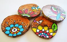 handpainted natural wooden 4 coasters in a flower and butterfly design.. $20.00, via Etsy.
