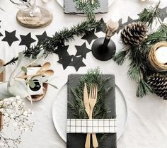 21 Amazing Creative Christmas Dining Table Ideas Christmas Place setting with slate Stars and Baby's breath floral arrangement and candles Christmas Dining Table, Christmas Table Centerpieces, Christmas Table Settings, Christmas Decorations, Holiday Decor, Christmas Tablescapes, Christmas Candles, Tree Decorations, Christmas Place