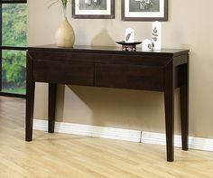 Add storage and style to your entryway with this modern two-drawer console table featuring a deep Halifax finish over a durable rubberwood construction. The drawers are great for stashing keys, mail, or other items that tend to pile up near your door.