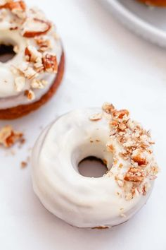 These baked pumpkin donuts with cream cheese frosting are going to get us ready for fall!