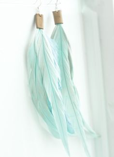 Mint earrings- mint blue feather and leather earrings