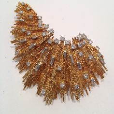 Yellow gold textured wire set with baguette and brilliant-cut diamonds || Andrew Grima, 1973