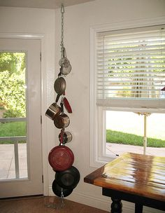 I think this could work if the chain wasn't dangling on the floor and if different pots were used to display