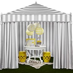 Temporary or permanent, a grey and white striped tent is a perfect addition to any backyard or patio. Z Gallerie Portofino Pavilion, $699.00