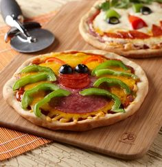 I found this recipe for Creepy Mini Pizza, on Breadworld.com. You've got to check it out!