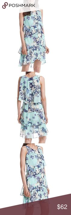 Mint/Blue Tiered Floral Dress-NWT Bring some delightful style to your look with this floral printed dress from S.L. Fashions that features tiers of fun style. Original price = $88.00. *Featured in mint, blues and ivory *Scoop neck *Tiered design *Allover floral print *sheer chiffon overlay *Lined *Polyester SL Fashions Dresses