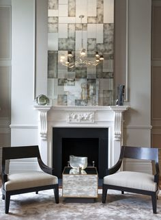Fireplace with antique mirror above and bespoke furniture, designed by Lawson Robb