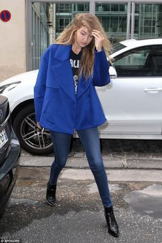 Into the blue: Earlier in the day Gigi also stepped out in an electric blue jacket over skinny Parker Smith jeans