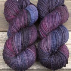 Mysterious eggplant purple with shifting creamy highlights and deep black shadows. This colorway is a Babette: every skein and every batch is a bit different, but Babs has a method of recreating these