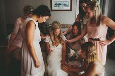 Bridesmaids praying with the bride before the ceremony - such a sweet moment captured by The Carrs Photography
