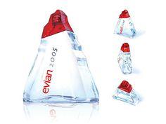 Evian. Les composants : La forme de la bouteille rappelle les reliefs alpins d'où l'eau minérale tire sa source (forme triangulaire et « morcelée »). Le graphisme («Evian 2005 ») indique l'ascension au sommet des glaciers et rappelle un grand cru daté de 2005. Les fonctions : Communication- Le packaging sobre et épuré rappelle la pureté de l'eau minérale. Cette eau minérale est unique (comme un grand cru) et se mérite (cf ascension aux sommets des glaciers).