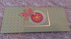 Backside of a pocket-card with flower and butterfly