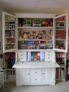 Ikea Hemnes secretary desk with hutch and two hemnes bookshelves for the sides. For a built-in look carefully remove molding and place it in the front. Viola!