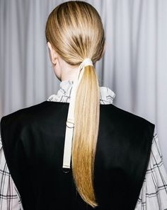 At Tibi, Aveda guest artist Frank Rizzieri gave the classic low pony an upgrade by adding belt-buckle ties produced specifically for the show to be used on the hair.