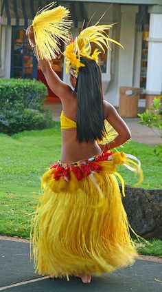 Hula dancer performing in Tahitian outfits by Frank Kovalchek