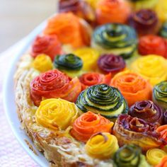 A stunning savory tart that will surprise your family: zucchini and carrots roses on a bed of ricotta, parmesan and mozzarella cheese.