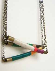 textile and leather with antiqued brass chain - seems like a possible DIY project