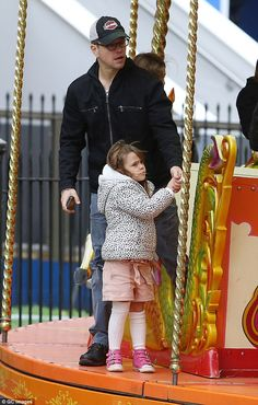 Top Dad:Matt Damon showed why he was such a great father, when he took two of his girls, Stella, 5 and Gia, 7 to London's Natural History Museum Ice Rink and funfair on Monday