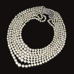 FORMERLY IN THE COLLECTION OF BARONESS DE RENZIS SONNINO: Natural pearl and diamond necklace. Composed of seven strands of natural pearls, to a clasp set with circular-, single-cut and cushion-shaped diamonds.