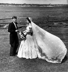 """""""Jackie's wedding gown was designed by Anne Lowe and created to go with Jackie's grandmother's wedding veil.  It was made of over fifty yards of ivory silk chiffon taffeta and featured a portrait neckline, large round bouffant skirt with rosettes and waxed orange blossom tucked into the pleated folds."""""""