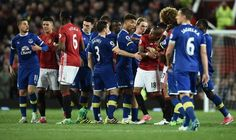 Everton's Belgian striker Kevin Mirallas remonstrates with Manchester United's French midfielder Paul Pogba as Everton's English defender Mason...