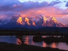 Dawn shining on mountains in the Parque Nacional Torres Del Paine, Chile Places To Travel, Places To See, Cool Winter, Purple Mountain Majesty, Skier, Torres Del Paine National Park, Destinations, Rocky Mountain National Park, Landscape Pictures