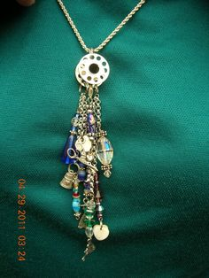 Necklace made from findings and a bobbin. Saw at Paducah, Ky. Quilt Show