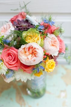 Colour mix of english garden roses, and seasonal fillers.