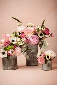 Pink flowers in birch wood containers
