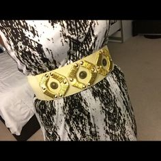 Bebe belt Brand new tan belt with gold embroidery and a three snap closure bebe Accessories Belts
