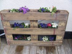 Wooden Pallet Flower Garden Come With Outdoor Pallet Wood Plant Pot And Varnished Pallet Wood Floor Tile Plus Varnished Pallet Wood Flower Racks Along With White Stain Wall
