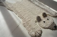 A hand-knit bear skin rug!  This would be so cute for a nursery.  There are a bunch of other animals too, cats, mice, foxes, bunnies.