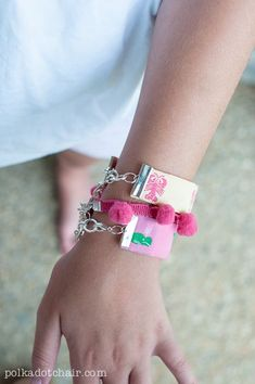 DIY Preppy Bracelets made from custom trim, pom pom and ribbon. A cute craft project for the kids during the summer