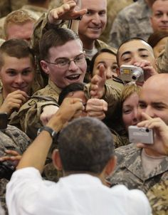 President Barack Obama greets troops during a visit to Afghanistan's Bagram Air Field Barack Obama Family, Fist Bump, Walking Alone, People Of The World, Us Presidents, World History, Latest Video, Afghanistan, Troops