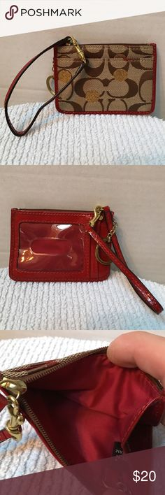 Coach change/ ID holder Pre owned Coach wristlet change ID holder and key ring. This is in excellent condition. Smoke and pet free house Coach Bags Clutches & Wristlets