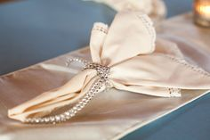 love love love this ... a simple napkin treatment with bling! Photography by kellanstudios.com