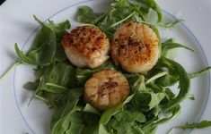 Coquilles Saint-Jacques in butter and olive oil.