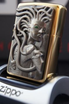 ZIPPO LIGHTER 24Ct GOLD PLATED SPECIAL EDITION 3D GREEN EYED GOLDEN MEDUSA RARE & UNUSUAL ZIPPO LIGHTERS, CASES.