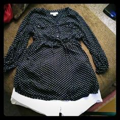 Maternity top Navy blue maternity top with small white polka dots. There is an elastic tie waist. 3/4 sleeves with buttons at the bottom of the sleeves. Goes great with the white maternity shorts I have listed! Motherhood Maternity Tops Blouses
