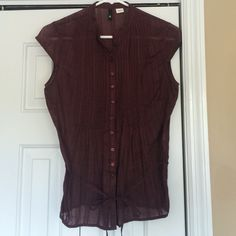 H&M Maroon Capped Sleeve Button Up Tank Like new. Pleated front with a tie around the waist. Sheer stripped linen texture. No trades please. H&M Tops Button Down Shirts