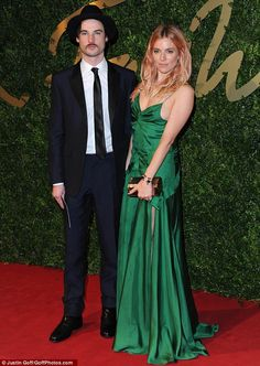 Sienna Miller (in Burberry dress and shoes, Roland Mouret clutch) and her fiancé Tom Sturridge - 2013 British Fashion Awards (December 2013)