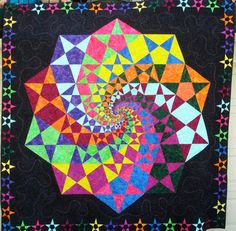 This is not a project I could tackle but I love the way the pattern and colors spiral around through the quilt.    Starry Night King Size Bed Quilt Finished by everywitchway on Etsy, $2000.00
