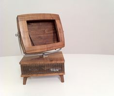 A very cool Retro style wooden iPad stand. Great idea.