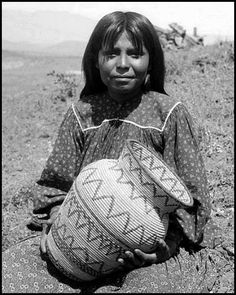 Apache girl seated and holding a basket. Photo- ca. 1900. National…
